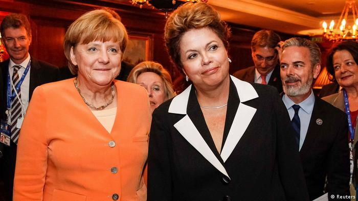 Brazil's President Dilma Rousseff (R) and German Chancellor Angela Merkel pose during a meeting at Santiago, in this photo provided by the Brazilian Presidency January 26, 2013. (Photo: REUTERS/Roberto Stuckert Filho)