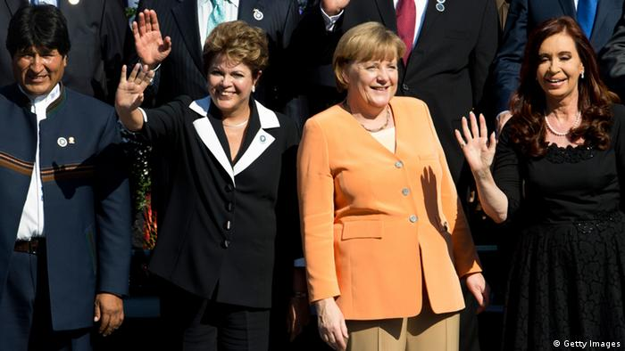 (L to R) Bolivia's President Evo Morales, Brazil's President Dilma Rousseff, German Chancellor Angela Merkel and Argetina's President Cristina Fernandez de Kirchner pose during the oficial picture of the Community of Latin American and Caribbean States (CELAC)-European Union (EU) Summit, on January 26, 2013.