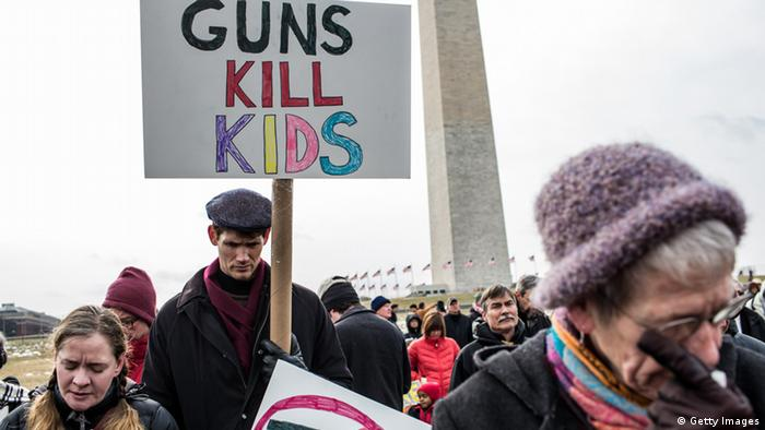 WASHINGTON, DC - JANUARY 26: (L-R) Cori Lynn Campbell, her husband Erik Singer, both of Maplewood, New Jersey, and Martha Nichols, of Vienna Virginia, participate in a rally on the National Mall for stricter gun control laws on January 26, 2013 in Washington, DC. Demonstrators included survivors of the shooting at Virginia Tech, Newtown, Connecticut, and others. (Photo by Brendan Hoffman/Getty Images)