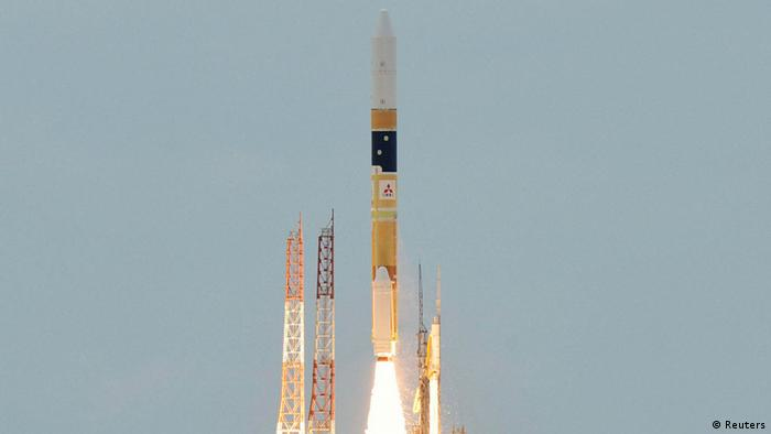 A H-2A rocket carrying an information gathering radar satellite blasts off from the launching pad at Tanegashima Space Center on the Japanese southwestern island of Tanegashima, about 1,000km (621 miles) southwest of Tokyo.