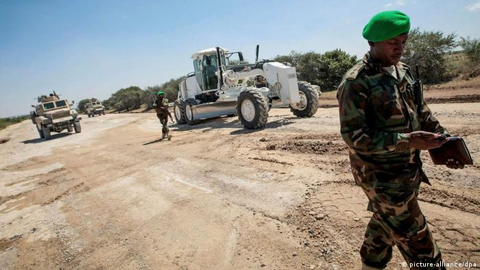 African Union Mission in Somalia (AMISOM) combat engineers repair and grade a stretch of road leading to the town of Afgooye in Somalia's Lower Shabelle region, along the main route linking the fertile, agricultural region with the capital Mogadishu in this picture provided by African Union-United Nations Information Support Team taken January 24, 2013 and received by Reuters January 26, 2013. After years under the control of the Al-Qaeda linked group Al Shabaab, stretches of the economically important thoroughfare were virtually in-passable. Now, 7 months after the Shabaab were forced to flee following Operation Free Shabelle, in which the Somali National Army, supported by AMISOM forces, liberated the Afgooye Corridor, the engineers have begun repairing the 4.5km (2.8 miles) stretch of road to increase ease and flow of traffic carrying people and produce to and from Mogadishu. REUTERS/AU-UN IST PHOTO/Stuart Price/Handout (SOMALIA - Tags: MILITARY POLITICS) ATTENTION EDITORS - THIS IMAGE WAS PROVIDED BY A THIRD PARTY. FOR EDITORIAL USE ONLY. NOT FOR SALE FOR MARKETING OR ADVERTISING CAMPAIGNS. THIS PICTURE IS DISTRIBUTED EXACTLY AS RECEIVED BY REUTERS, AS A SERVICE TO CLIENTS
