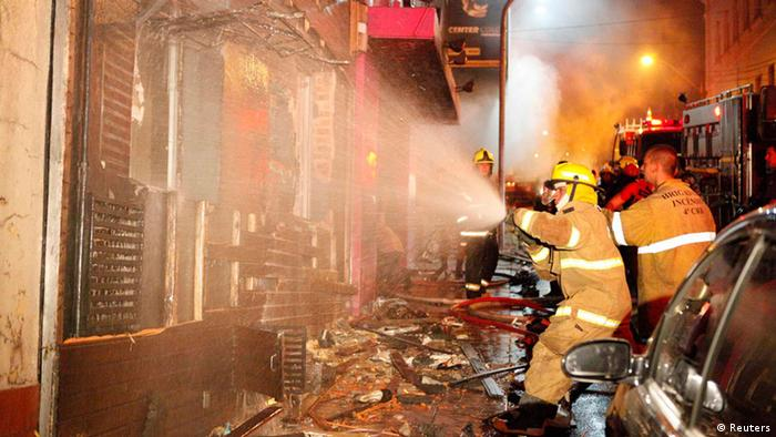 Fire-fighters try to extinguish a fire at Kiss nightclub in the southern city of Santa Maria, Brasil.