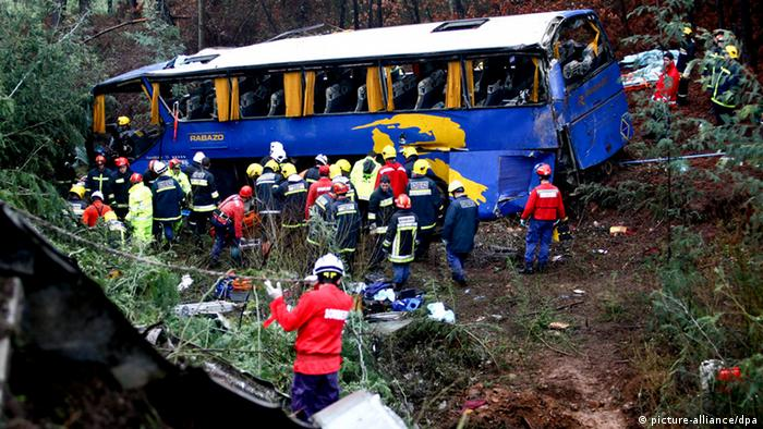 epa03558315 Firefighters work next to the bus that went off this morning and fell in a ravine in Serta district of Castelo Branco, central Portugal, 27 January 2013. At least 10 people died in the bus accident in eastern Portugal after the vehicle plunged down an embankment. The 33 other passengers on the coach bus were injured, six of them seriously, according to emergency responders. The bus was traveling north from the Castelo Branco region. Authorities are still investigating why it went off the road. EPA/PAULO NOVAIS