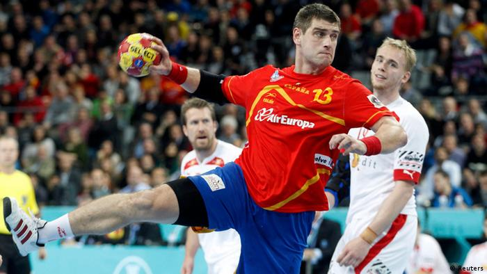 Spain's Julen Aguinagalde attempts to score against Denmark during their Men's Handball World Championship final match at the Palau Sant Jordi arena in Barcelona January 27, 2013. (Photo: REUTERS/Gustau Nacarino)