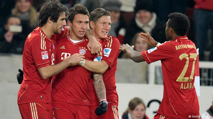 Munich's Croatian forward Mario Mandzukic (2nd L) is congratulated by his teammates Munich's Spanish midfielder Javier Martinez (L), Munich?s midfielder Bastian Schweinsteiger (2nd R) and Munich?s Austrian defender David Alaba (R) after scoring the 0-1 during the German first division Bundesliga football match between VfB Stuttgart and Bayern Munich in Stuttgart, southwestern Germany, on January 27, 2013. AFP PHOTO / THOMAS KIENZLE RESTRICTIONS / EMBARGO - DFL RULES TO LIMIT THE ONLINE USAGE DURING MATCH TIME TO 15 PICTURES PER MATCH. IMAGE SEQUENCES TO SIMULATE VIDEO IS NOT ALLOWED AT ANY TIME. FOR FURTHER QUERIES PLEASE CONTACT THE DFL DIRECTLY AT + 49 69 650050. (Photo credit should read THOMAS KIENZLE/AFP/Getty Images)