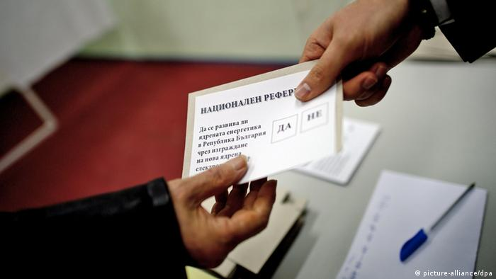 epa03557809 Voter takes a ballot with text 'To develop a nuclear energy in Bulgaria by building a new nuclear power plant?' before voting at a polling station during the national referendum on the future of Bulgaria's nuclear energy, Sofia, Bulgaria 27 January 2013. Bulgarians began casting ballots Sunday in the first democratic referendum in the Balkan country. The vote is about the future of nuclear project with Russia at Belene on the Danube river. But turnout is expected to fall short of the required 60 per cent because many voters are confused by the question: 'Should nuclear energy be developed in Bulgaria through the construction of a new nuclear power plant?'. The center-right government of Prime Minister Boyko Borisov stopped the construction of the Belene nuclear plant due to its high costs for the poorest EU member state. The opposition Socialists, on the contrary, are in favour of a new nuclear plant, the country's second after the Soviet style Kozloduy nuclear power plant. EPA/VASSIL DONEV +++(c) dpa - Bildfunk+++