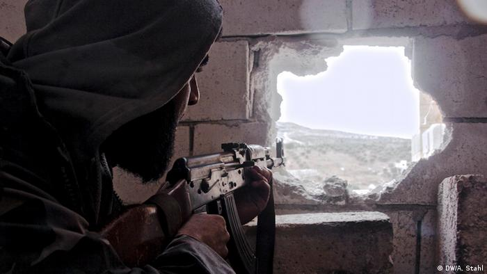 Mohammed, 27, takes aim at regime forces. Shot in the foot by a sniper the previous day, Mohammed now occupies the same position he was targeted from. Harem, Syria *** Deutsche Welle, Andreas Stahl, Januar 2013
