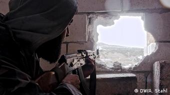 Mohammed, 27, takes aim at regime forces. Photo: Deutsche Welle, Andreas Stahl, January 2013