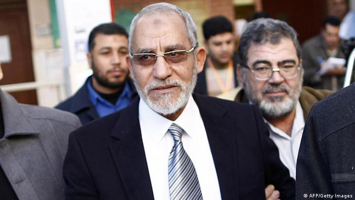 Egypt's Muslim Brotherhood leader Mohammed Badie (C) leaves a polling station after voting during the second round of a referendum on a new draft constitution in Beni Sueif, south of Cairo, on December 22, 2012. Egyptians are voting in the final round of a referendum on a new constitution championed by President Mohamed Morsi and his Islamist allies against fierce protests from the secular-leaning opposition. AFP PHOTO/MAHMUD KHALED (Photo credit should read MAHMUD KHALED/AFP/Getty Images)