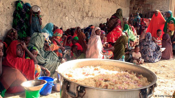 Somali refugee families at a feeding center in Mogadishu (Photo: Abdurashid Abikara)
