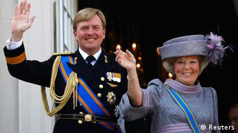 Netherlands' Queen Beatrix (R) and her son Crown Prince Willem-Alexander are seen waving to well-wishers from the balcony of the Royal Noordeinde Palace after opening the new parliamentary year in The Hague on this April 15, 2011 file photo. Dutch Queen Beatrix will address the nation on television and radio on the evening of January 28, 2013, the Royal Household said in a statement, prompting the Dutch media to report that she would abdicate in favour of her son, Prince Willem-Alexander. REUTERS/Jerry Lampen/Files (NETHERLANDS - Tags: ROYALS POLITICS)