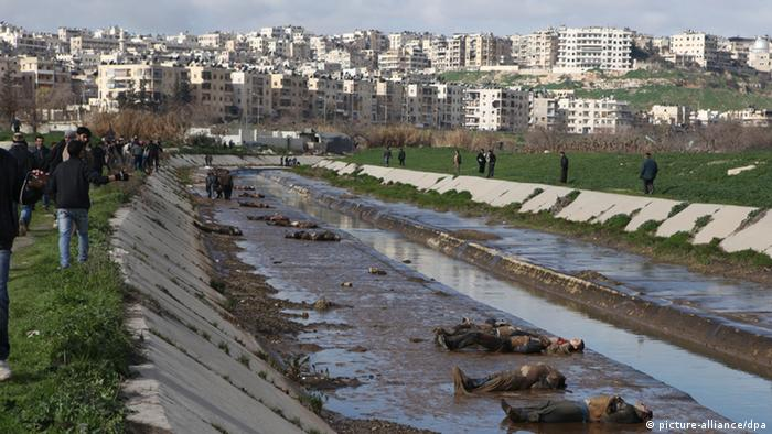 Bodies along the banks of a river in Aleppo