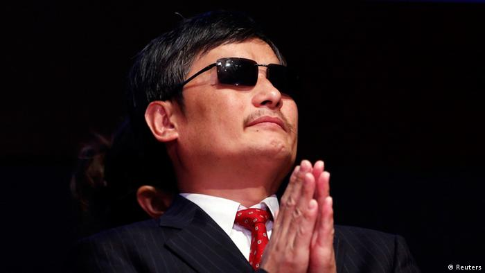 Chinese dissident Chen Guangcheng listens to remarks during a ceremony awarding him The Tom Lantos Human Rights Prize in the Capitol in Washington January 29, 2013. Behind Chen is a translator. REUTERS/Kevin Lamarque (UNITED STATES - Tags: POLITICS)