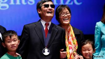 Chinese dissident Chen Guangcheng, his wife Yuan Weijing and their children appear onstage after Chen received The Tom Lantos Human Rights Prize in the Capitol in Washington January 29, 2013. REUTERS/Kevin Lamarque (UNITED STATES - Tags: POLITICS TPX IMAGES OF THE DAY)