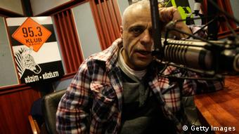 A journalist on air with Klubradio FERENC ISZA/AFP/Getty Images