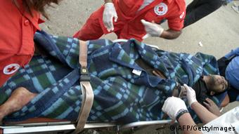 An injured helped by the Red Cross AFP/GettyImages