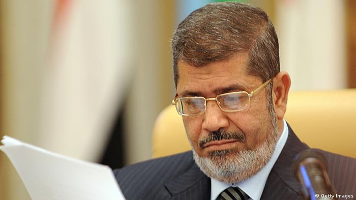 Egypt's President Mohamed Mursi looks at documents at the start of the third Arab Economic, Social and Development Summit, on January 21, 2013, in Riyadh. Saudi Arabia is hosting the two day summit aimed at relaunching regional cooperation in the face of economic challenges which were at the root of the Arab Spring uprisings. AFP PHOTO/FAYEZ NURELDINE (Photo credit should read FAYEZ NURELDINE/AFP/Getty Images)