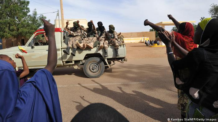 People cheer as soldiers of Malian Colonel Alaji Ag Gamou enter Ansongo on January 29, 2013. Ansongo is a town south of the northern Malian city of Gao. (Photo: KAMBOU SIA/AFP/Getty Images)