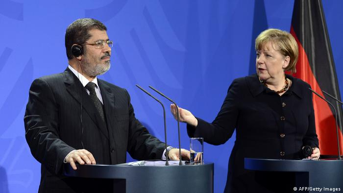 German Chancellor Angela Merkel and Egyptian President Mohamed Morsi give a joint press conference following a meeting at the Chancellery in Berlin on January 30, 2013. JOHN MACDOUGALL/AFP/Getty Images)
