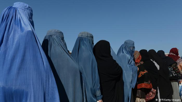 Afghan women line up to receive winter supplies at a UNHCR distribution centre for needy refugees at the Women's Garden in Kabul (Photo: credit should read SHAH MARAI/AFP/Getty) Images)