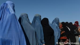 Afghan women line up to receive winter supplies at a UNHCR distribution centre on January 2, 2013. (SHAH MARAI/AFP/Getty Images)