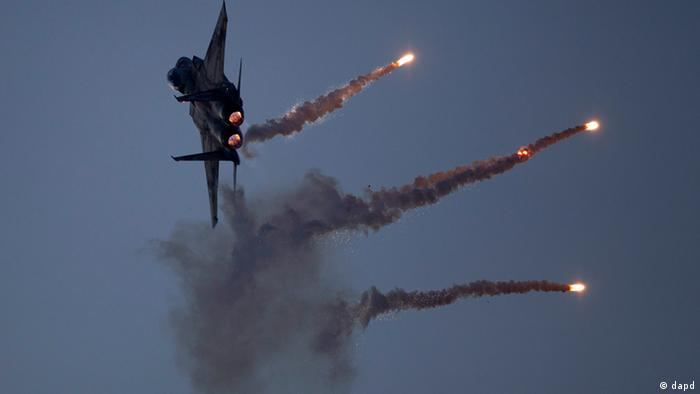 An Israeli Air Force fighter jet releases flares during an acrobatics display during a graduation ceremony in the Hatzerim air force base near the southern city of Beersheba, Israel, Thursday, Dec. 27, 2012. (Photo:Ariel Schalit/AP/dapd)