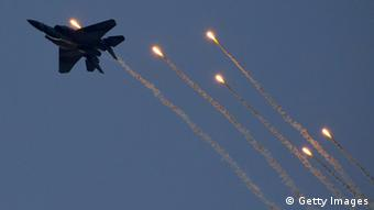 An Israeli F-15 I fighter jet launches anti-missile flares during an air show at the graduation ceremony of Israeli pilots at the Hatzerim air force base in the Negev desert, near the southern Israeli city of Beersheva, on December 27, 2012. AFP PHOTO / JACK GUEZ (Photo credit should read JACK GUEZ/AFP/Getty Images)