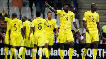 Togo's Emmanuel Adebayor (4) celebrates scoring a goal during their African Nations Cup Group D soccer match against Tunisia in Nelspruit, January 30, 2013. REUTERS/Thomas Mukoya (SOUTH AFRICA - Tags: SPORT SOCCER)
