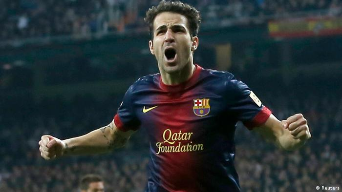 Barcelona's Cesc Fabregas celebrates his goal against Real Madrid during their Spanish King's Cup semi final first leg soccer match at Santiago Bernalbeu stadium in Madrid January 30, 2013. REUTERS/Juan Medina (SPAIN - Tags: SPORT SOCCER)