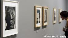 epa03133060 A woman looks at photographic portraits of Spanish artist Pablo Picasso during an exhibition at the Picasso Museum in Malaga, Spain, 05 March 2012. The exhibtion, entitled MemyselfandI. Photographic Portraits of Picasso, presents 166 photographies by 34 authors, among them Man Ray, Robert Capa and Henri Cartier-Bresson; it opens to the public until 10 June. EPA/CARLOS DIAZ +++(c) dpa - Bildfunk+++