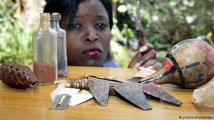 A worker with some of the tools used for FGM in Africa. (Photo: Ursula Düren/dpa)