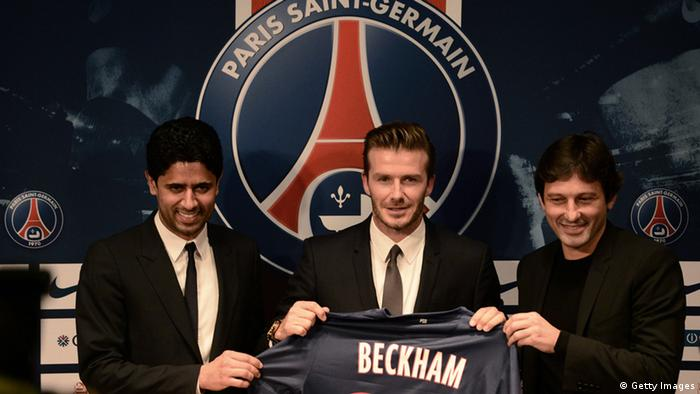 Former England captain David Beckham (C) poses with his new jersey as he gives a press conference flanked by PSG Qatari president Nasser Al-Khelaifi (L) and PSG sports director Leonardo at the Parc des Princes stadium in Paris, on January 31, 2013, to announce that he joined the French football club Paris Saint-Germain (PSG). AFP PHOTO / FRANCK FIFE (Photo credit should read FRANCK FIFE/AFP/Getty Images)