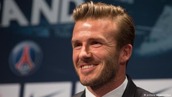 epa03563044 British football player David Beckham poses during a news conference to announce signing with Paris Saint Germain football club, at the Parc des Princes stadium in Paris, France, 31 January 2013. EPA/IAN LANGSDON