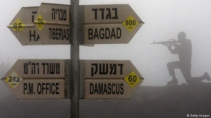 A sculpture of an Israeli soldier standing guard is seen next to a sign for tourists showing the different distances to Jerusalem, Baghdad, Damascus and other locations, at an army post in Mount Bental in the annexed Golan Heights on January 31, 2013. Iran's deputy foreign minister said that the alleged Israeli air strike on a Syrian military research facility a day earlier will have grave consequences. AFP PHOTO / JACK GUEZ (Photo credit should read JACK GUEZ/AFP/Getty Images)