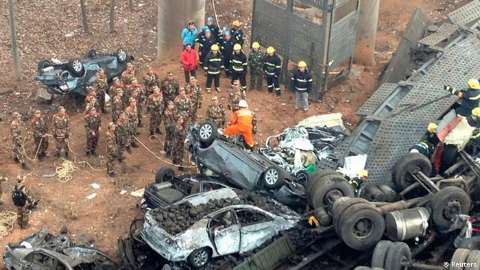Rescuers look for survivors near the wreckage of vehicles after a expressway bridge partially collapsed on the Lianhuo highway in Mianchi county, Henan province February 1, 2013. (Photo via Reuters)