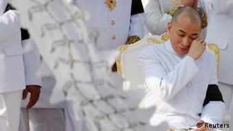 Cambodia's King Norodom Sihamoni cries as a coffin with remains of his father, the late former King Norodom Sihanouk is taken from the Royal Palace towards the crematorium in Phnom Penh February 1, 2013. Sihanouk died at age 89 of heart failure on October 15, 2012 and his body will cremated on February 4, 2013. REUTERS/Damir Sagolj (CAMBODIASOCIETY ROYALS - Tags: ENTERTAINMENT SOCIETY OBITUARY ROYALS TPX IMAGES OF THE DAY)