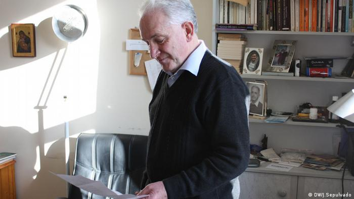 Flannery reading a letter in his office