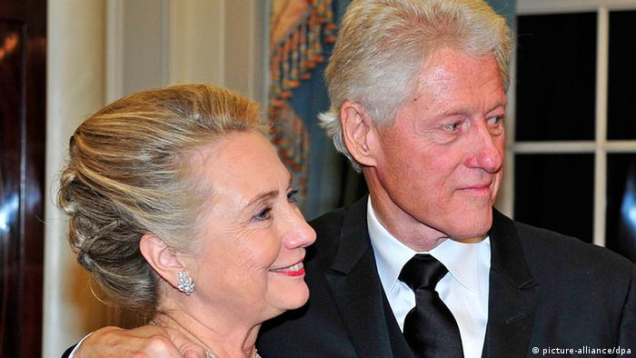 Former United States President Bill Clinton (R) and U.S. Secretary of State Hillary Rodham Clinton look on as they wait for the seven recipients of the 2012 Kennedy Center Honors to pose for a photo following a dinner hosted by Secretary Clinton at the U.S. Department of State in Washington, D.C. late 01 December 2012. The 2012 honorees are US blues musician Buddy Guy, US actor Dustin Hoffman, US late-night host David Letterman, Russian prima ballerina Natalia Makarova, and members of the British rock band Led Zeppelin, Robert Plant, Jimmy Page, and John Paul Jones. EPA/RON SACHS / POOL