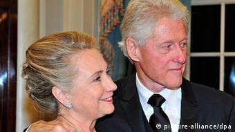 epa03493843 Former United States President Bill Clinton (R) and U.S. Secretary of State Hillary Rodham Clinton look on as they wait for the seven recipients of the 2012 Kennedy Center Honors to pose for a photo following a dinner hosted by Secretary Clinton at the U.S. Department of State in Washington, D.C. late 01 December 2012. The 2012 honorees are US blues musician Buddy Guy, US actor Dustin Hoffman, US late-night host David Letterman, Russian prima ballerina Natalia Makarova, and members of the British rock band Led Zeppelin, Robert Plant, Jimmy Page, and John Paul Jones. EPA/RON SACHS / POOL