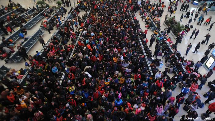 A crowd of Chinese passengers on their way back for the Spring Festival or the Chinese New Year queue up to check in at the Shenyang North Railway Station in Shenyang city, northeast Chinas Liaoning province, 26 January 2013. Chinese authorities added extra travel contingencies to ensure the smooth kick-off on Saturday (26 January 2013) of the worlds largest annual migration that starts before the Lunar New Year. Railway authorities arranged 358 more passenger trains on Saturday to start handling the estimated 5.2 million daily trips over the next 40 days peak travel season, said Zhao Chunlei, an official with the Ministry of Railways. A record 3.41 billion trips are expected to be made over this years Lunar New Year travel rush, as Chinese who have worked away from home see the holiday as the most important occasion for family reunion. The countrys rail network is expected to handle 225 million trips, while long-distance buses will see up to 3.1 billion passengers, which combine to account for 99 percent of the overall national capacity, according to the National Development and Reform Commission.