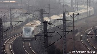 This picture taken on January 17, 2013 shows a train travelling along the tracks as it comes into a railway station in Qingdao, in eastern China's Shandong province. (Photo: STR/AFP/Getty Images)