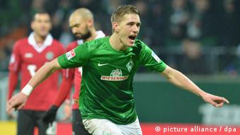 Werder Bremen's Nils Petersen celebrates a goal against Hannover 96.