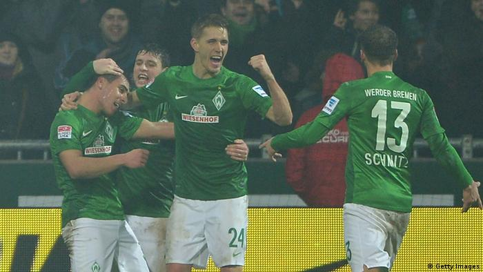BREMEN, GERMANY - FEBRUARY 01: Nils Petersen of Bremen celebrates scoring the second goal during the Bundesliga match between SV Werder Bremen and Hannover 96 at Weser Stadium on February 1, 2013 in Bremen, Germany. (Photo by Stuart Franklin/Bongarts/Getty Images)