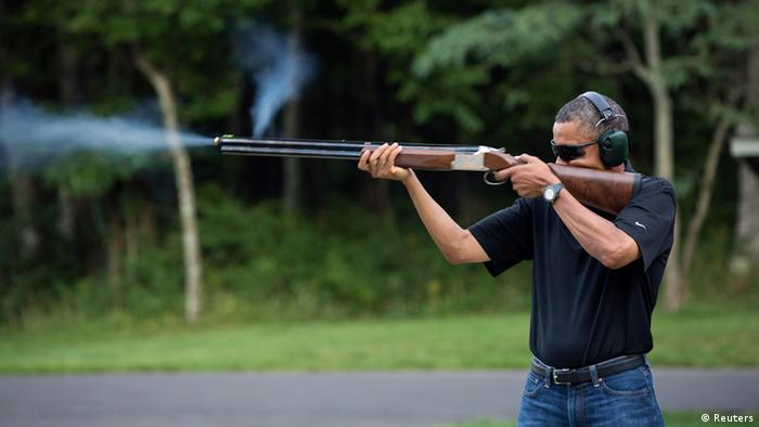 President Barack Obama shoots clay targets on the range at Camp David, Maryland, in this White House handout photo taken August 4, 2012. REUTERS/White House/Pete Souza/Handout (UNITED STATES - Tags: POLITICS TPX IMAGES OF THE DAY) FOR EDITORIAL USE ONLY. NOT FOR SALE FOR MARKETING OR ADVERTISING CAMPAIGNS. THIS IMAGE HAS BEEN SUPPLIED BY A THIRD PARTY. IT IS DISTRIBUTED, EXACTLY AS RECEIVED BY REUTERS, AS A SERVICE TO CLIENTS