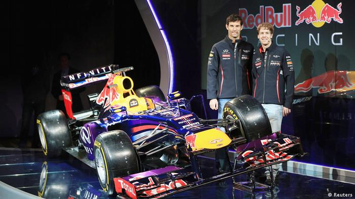 Drivers Mark Webber of Australia (L) and Sebastian Vettel of Germany are seen posing for a photograph, in this picture provided by Red Bull, with the new car during the Infiniti Red Bull Racing RB9 launch, in Milton Keynes central England February 3, 2013. REUTERS/Red Bull/Handout (BRITAIN - Tags: SPORT MOTORSPORT) ATTENTION EDITORS - THIS IMAGE WAS PROVIDED BY A THIRD PARTY. FOR EDITORIAL USE ONLY. NOT FOR SALE FOR MARKETING OR ADVERTISING CAMPAIGNS. THIS PICTURE IS DISTRIBUTED EXACTLY AS RECEIVED BY REUTERS, AS A SERVICE TO CLIENTS. NO SALES. NO ARCHIVES