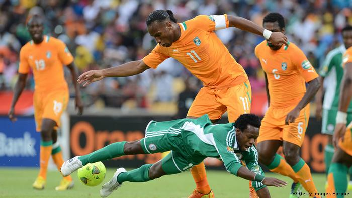 RUSTENBURG, SOUTH AFRICA - FEBRUARY 03: Ogenyi Onazi of Nigeria and Didier Drogba of Ivory Coast compete during the 2013 Orange African Cup of Nations 3rd Quarter Final match between Ivory Coast and Nigeria, at Royal Bafokeng Stadium on February 03, 2013 in Rustenburg, South Africa. (Photo by Lefty Shivambu/Gallo Images/Getty Images)