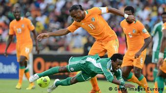 Players from Ivory Coast and Nigeria tussle out for the ball (Photo by Lefty Shivambu/Gallo Images/Getty Images)