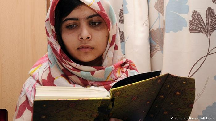 FILE - In this undated file photo provided by Queen Elizabeth Hospital in Birmingham, England, Malala Yousufzai, the 15-year-old girl who was shot at close range in the head by a Taliban gunman in Pakistan, reads a book as she continues her recovery at the hospital. doctors said Wednesday, Jan. 30, 2013, that Yousufzai is headed toward a full recovery once she undergoes a final surgery to reconstruct her skull. (AP Photo/Queen Elizabeth Hospital, File)