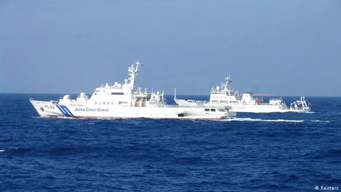 Chinese marine surveillance ship Haijian No. 51 (R) cruises next to a Japan Coast Guard patrol ship, Akaishi, in the East China Sea near the disputed isles known as Senkaku isles in Japan and Diaoyu islands in China, in this handout photo released by the 11th Regional Coast Guard Headquarters-Japan Coast Guard February 4, 2013. Two Chinese maritime surveillance vessels entered Japan's territorial waters on Monday around the disputed isles in the East China Sea, Kyodo News reported. Mandatory Credit REUTERS/11th Regional Coast Guard Headquarters-Japan Coast Guard/Handout (JAPAN - Tags: POLITICS) ATTENTION EDITORS - THIS IMAGE WAS PROVIDED BY A THIRD PARTY. FOR EDITORIAL USE ONLY. NOT FOR SALE FOR MARKETING OR ADVERTISING CAMPAIGNS. THIS PICTURE IS DISTRIBUTED EXACTLY AS RECEIVED BY REUTERS, AS A SERVICE TO CLIENTS. MANDATORY CREDIT