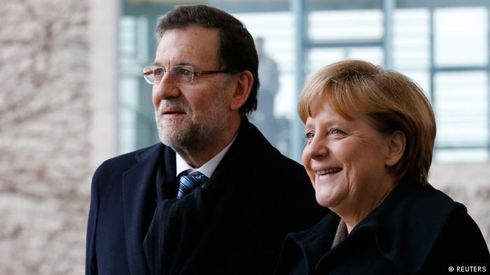 Merkel y Rajoy.